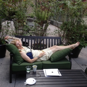 Me, reclining with chemo overnight bag pumping away, on the cancer terrace.