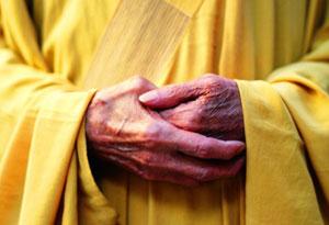 201003-omag-buddhist-monk-300x205